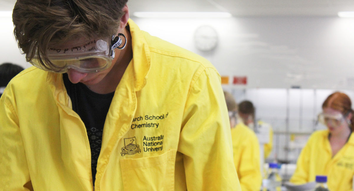 NYSF students wearing bright yellow scientist uniforms