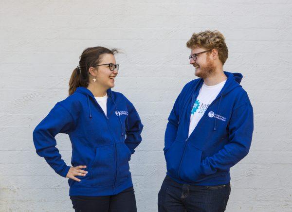 Female and male showcasing blue jacket