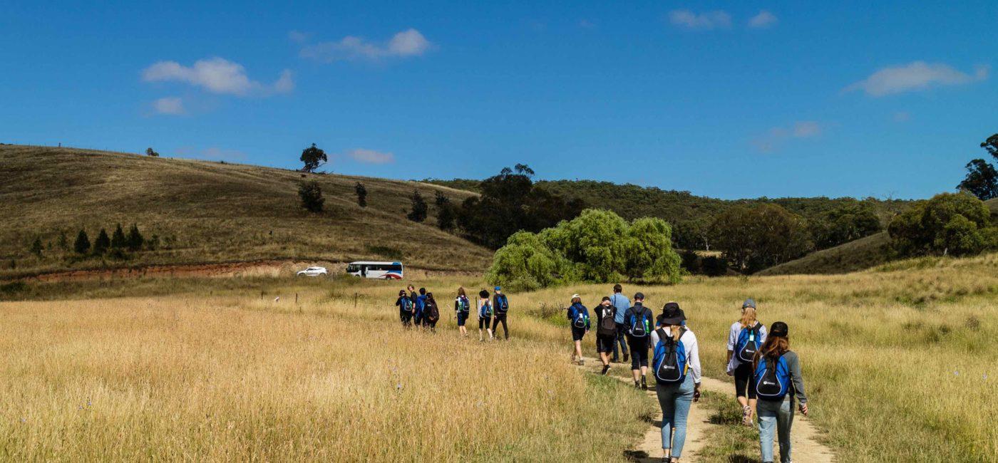 Students walking in a field
