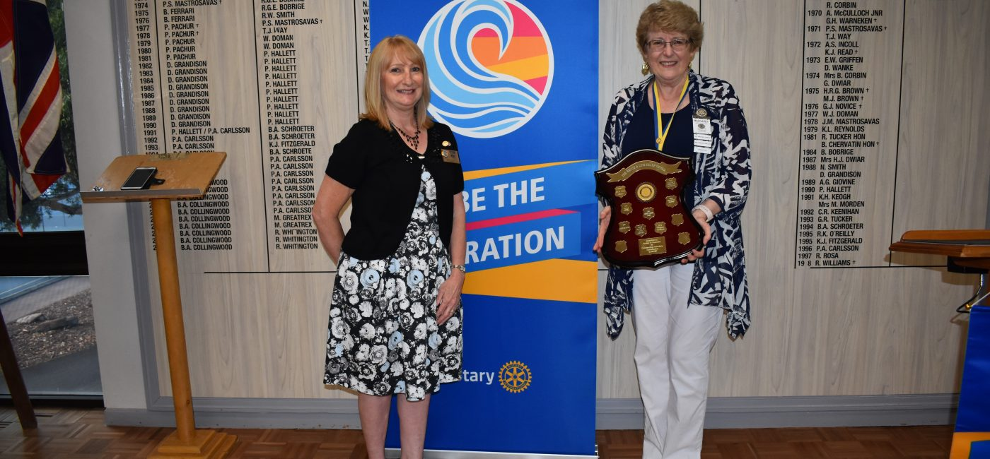 Rotary District Governor 9520 Kim Harvey presenting the Bruce and Lois Sharp Award to Margaret Northcote, NYSF District Chair 9520